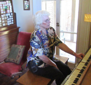 Marjorie at the player piano